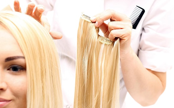Doing hair extension for woman