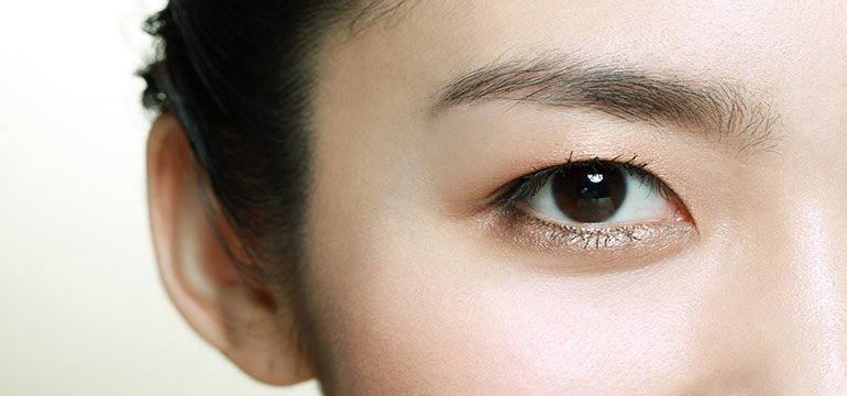 An Asian woman with hooded eyes